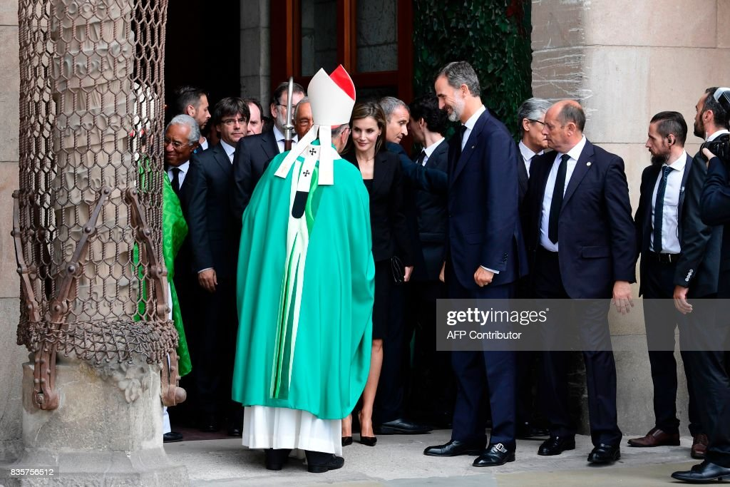 Spain's King Felipe VI (C-R) and Spain's Queen Letizia (C) speak with Archbishop of Barcelona, Cardinal Joan Josep Omella (C-L) as they leave after a mass to commemorate victims of two devastating terror attacks in Barcelona and Cambrils, at the Sagrada Familia church in Barcelona on August 20, 2017. A grief-stricken Barcelona prepared today to commemorate victims of two devastating terror attacks at a mass in the city's Sagrada Familia church. As investigators scrambled to piece together the attacks which killed 14 people in all, Interior Minister Juan Ignacio Zoido said on August 19 the cell behind the carnage that also injured 120 and plunged the country into shock had been 'dismantled,' though local authorities took a more cautious tone. SORIANO