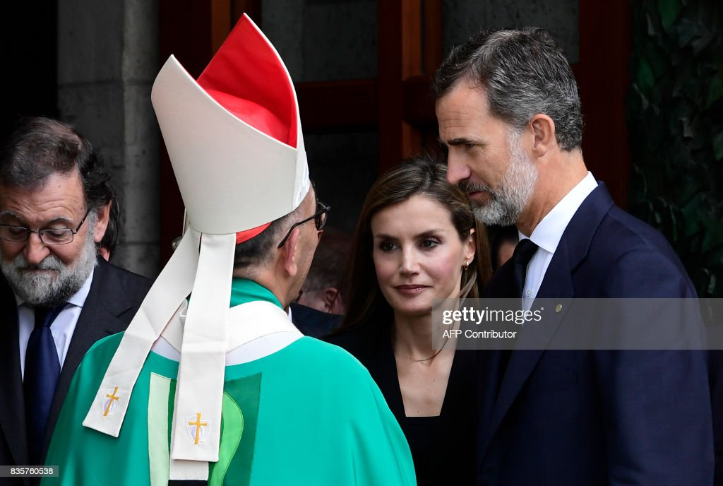 Spain's King Felipe VI (R) and Spain's Queen Letizia (C) speak with Archbishop of Barcelona, Cardinal Joan Josep Omella (C-L) as they leave after a mass to commemorate victims of two devastating terror attacks in Barcelona and Cambrils, at the Sagrada Familia church in Barcelona on August 20, 2017. A grief-stricken Barcelona prepared today to commemorate victims of two devastating terror attacks at a mass in the city's Sagrada Familia church. As investigators scrambled to piece together the attacks which killed 14 people in all, Interior Minister Juan Ignacio Zoido said on August 19 the cell behind the carnage that also injured 120 and plunged the country into shock had been 'dismantled,' though local authorities took a more cautious tone. SORIANO