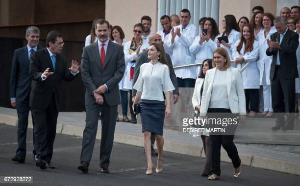 Spain's King Felipe VI and Spain's Queen Letizia walks away after posing a family pictures with members of the University of La Laguna during the...