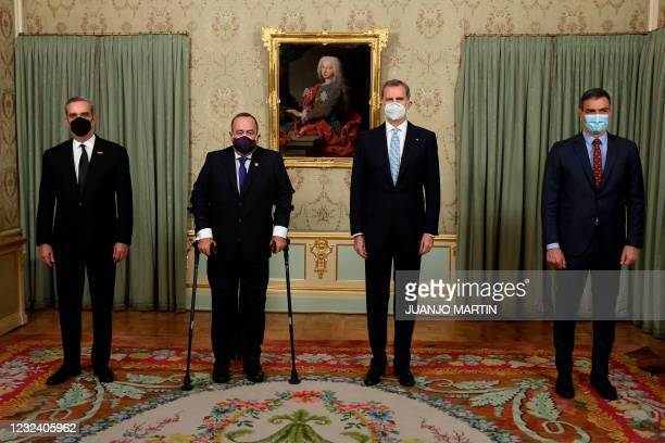 Spain's King Felipe VI and Spanish Prime Minister Pedro Sanchez pose with Guatemalan President Alejandro Giammattei and his Dominican counterpart...