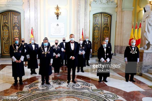 Spain's King Felipe VI and Supreme Court chief justice Carlos Lesmes pose with judges and magistrates during a ceremony marking the beginning of the...