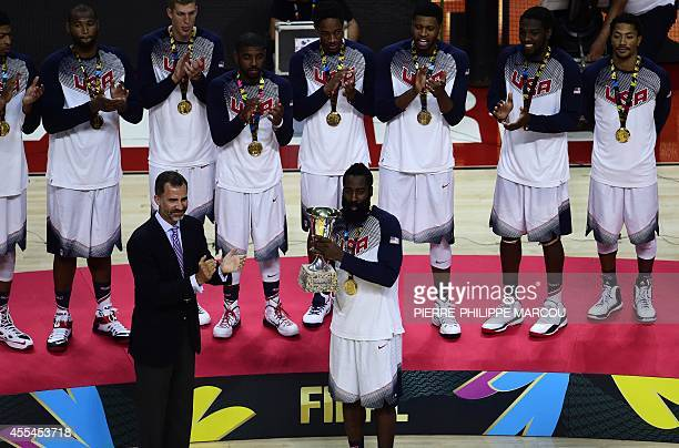 Spain's King Felipe VI applauds after giving the trophy to US forward James Harden after the 2014 FIBA World basketball championships final match USA...