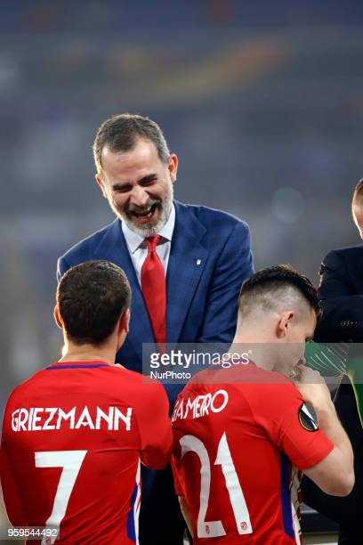 Spain's King Felipe VI congratulates Madrid's Antoine Griezmann and Kevin Gameiro after winningthe UEFA Europa League Final between Olympique de...