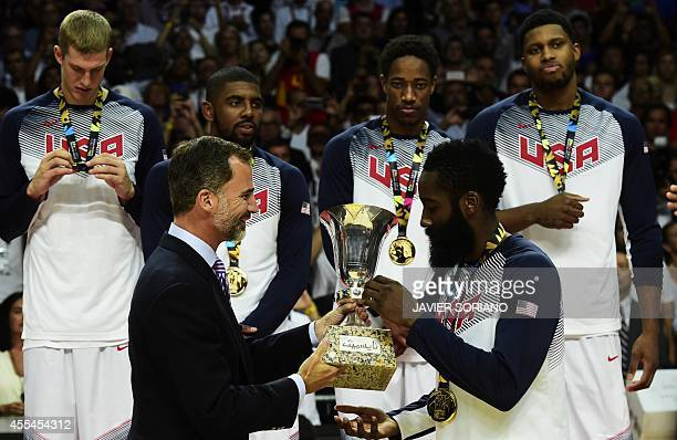 Spain's King Felipe VI gives the trophy to US forward James Harden after the 2014 FIBA World basketball championships final match USA vs Serbia at...