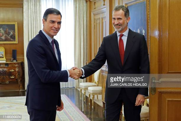 Spain's King Felipe VI greets Spanish Prime Minister and Socialist Party leader Pedro Sanchez upon his arrival for a meeting at the Zarzuela Palace...