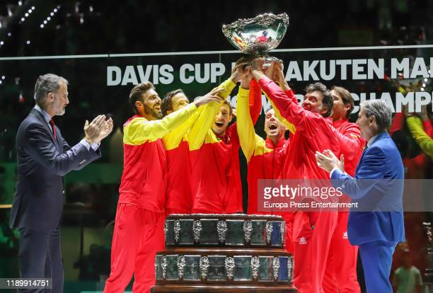 Spain´s King Felipe VI hands the trophy to Spain's captain Sergi Bruguera Spain's Marcel Granollers Spain's Feliciano Lopez Spain's Pablo Carreno...
