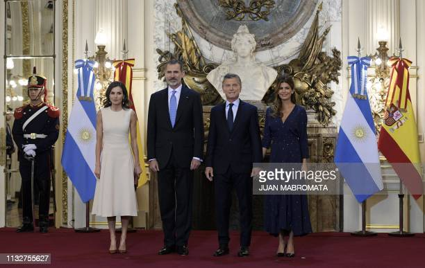 Spain's King Felipe VI , his wife Queen Letizia , Argentina's President Mauricio Macri and his wife First Lady Juliana Awada pose for pictures during...