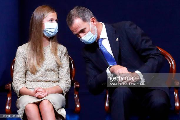 Spain's King Felipe VI listens to his daughter Crown Princess Leonor during the 2020 Princess of Asturias award ceremony at the Reconquinta Hotel in...