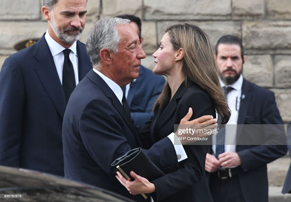 Spain's King Felipe VI (L) looks on as Spain's Queen Letizia (R) greets Portugal's President Marcelo Rebelo de Sousa (L) upon his arrival for a mass to commemorate victims of two devastating terror attacks in Barcelona and Cambrils, at the Sagrada Familia church in Barcelona on August 20, 2017. A grief-stricken Barcelona prepared today to commemorate victims of two devastating terror attacks at a mass in the city's Sagrada Familia church. As investigators scrambled to piece together the attacks which killed 14 people in all, Interior Minister Juan Ignacio Zoido said on August 19 the cell behind the carnage that also injured 120 and plunged the country into shock had been 'dismantled,' though local authorities took a more cautious tone. GUYOT