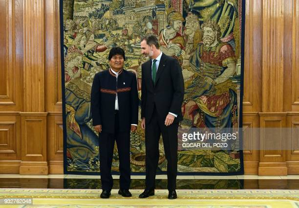 Spain's King Felipe VI poses with Bolivian President Evo Morales during a meeting at the Zarzuela Palace in El Pardo near Madrid on March 16, 2018. /...