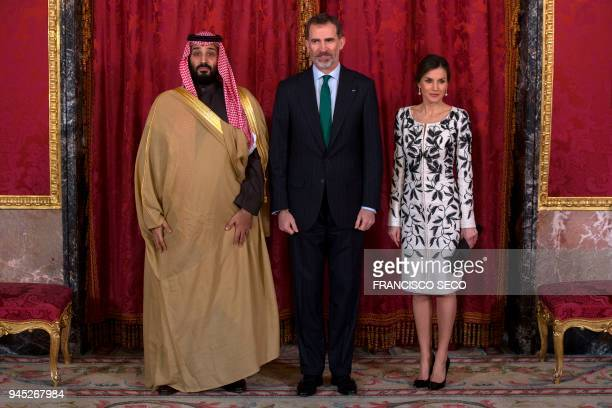 Spain's king Felipe VI poses with his wife queen Letizia and Saudi crown prince Mohammed bin Salman before a lunch at the Royal Palace in Madrid on...