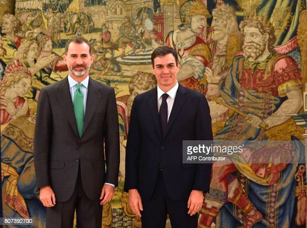 Spain's King Felipe VI poses with leader of the Spanish Socialist Party Pedro Sanchez at the Zarzuela palace in El Pardo near Madrid on July 4 2017 /...