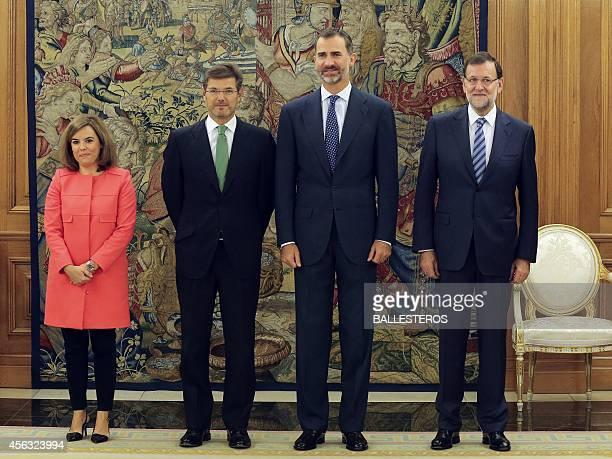 Spain's King Felipe VI poses with Spanish Prime Minister Mariano Rajoy Deputy Prime Minister and government spokeswoman Soraya Saenz de Santamaria...