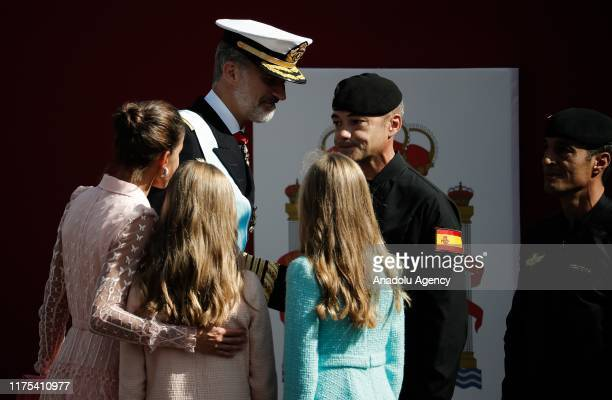 Spain's King Felipe VI Queen Letizia Crown Princess Leonor and Princess Sofia greet the paratrooper who got caught in a lamp post during National Day...
