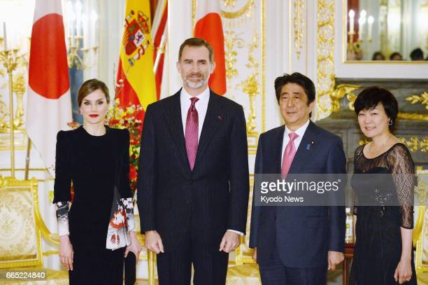 Spain's King Felipe VI Queen Letizia Japanese Prime Minister Shinzo Abe and his wife Akie pose for photos at the Akasaka Palace state guesthouse in...