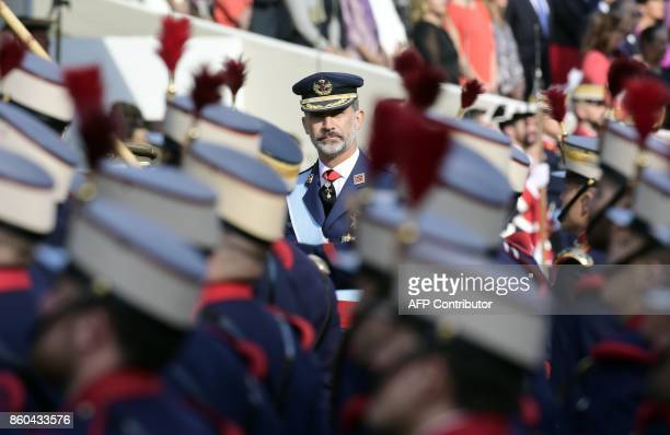 TOPSHOT Spain's King Felipe VI reviews the troops during the Spanish National Day military parade in Madrid on October 12 2017 Spain marks its...