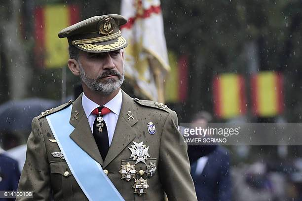 Spain's King Felipe VI reviews troops during the Spanish National Day military parade in Madrid on October 12 2016 SORIANO