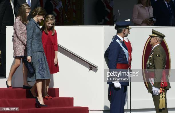 Spain's King Felipe VI Spain's Queen Letizia Spain's princess Leonor and princess Sofia leave after attending the Spanish National Day military...
