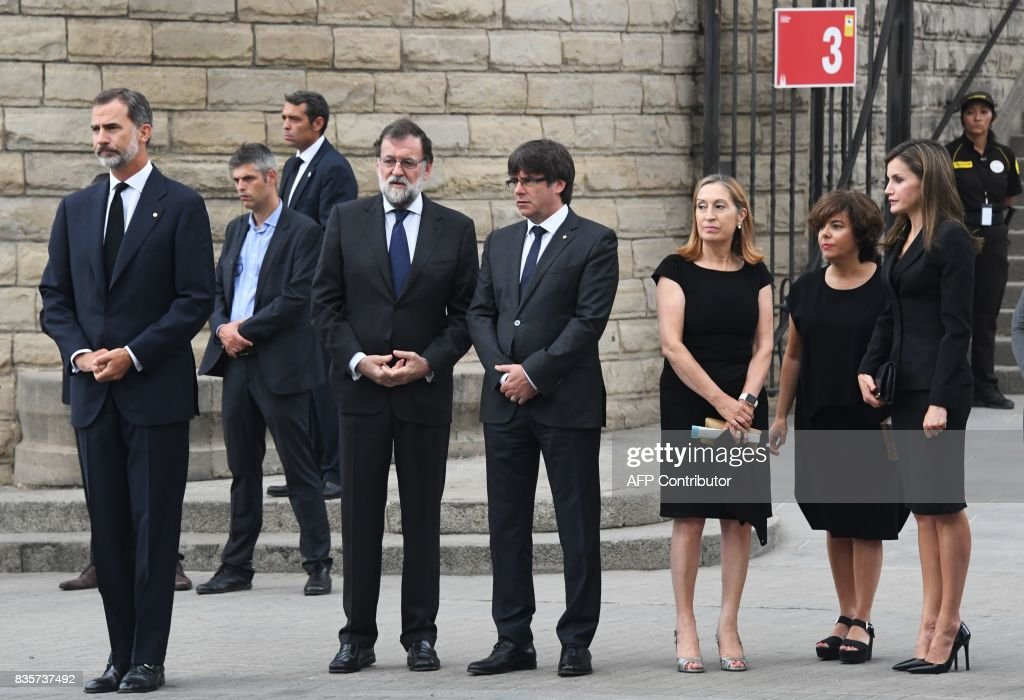 Spain's King Felipe VI, Spanish Prime Minister Mariano Rajoy, President of Catalonia Carles Puigdemont, Spanish vice-President of the Government and Minister of the Presidency and of the Regional Administrations Soraya Saenz de Santamaria, President of the Congress Ana Pastor and Spain's Queen Letizia arrive at the Sagrada Familia basilica in Barcelona on August 20, 2017, before a mass to commemorate victims of two devastating terror attacks in Barcelona and Cambrils. A grief-stricken Barcelona prepared today to commemorate victims of two devastating terror attacks at a mass in the city's Sagrada Familia church. As investigators scrambled to piece together the attacks which killed 14 people in all, Interior Minister Juan Ignacio Zoido said on August 19 the cell behind the carnage that also injured 120 and plunged the country into shock had been 'dismantled,' though local authorities took a more cautious tone. GUYOT