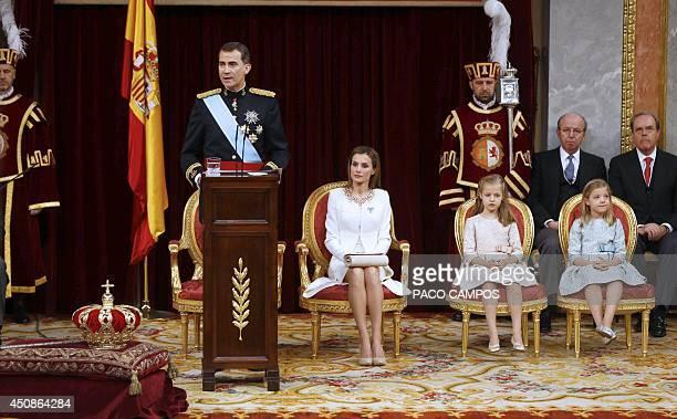 Spain's King Felipe VI speaks as Spain's Queen Letizia Spanish Crown Princess of Asturias Leonor and Spanish Princess Sofia look on at the Congress...
