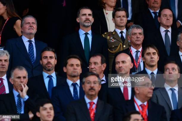 Spain's King Felipe VI stands past Spanish Minister of Education Culture and Sports and Government spokesperson Inigo Mendez de Vigo as they attend...