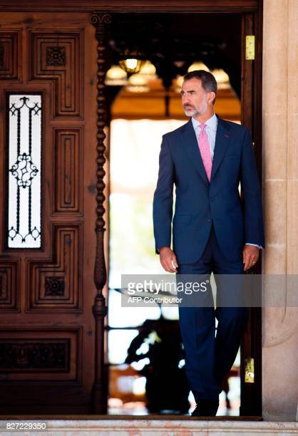 Spain's King Felipe VI waits for Spanish Prime Minister Mariano Rajoy before their meeting at the Marivent Palace in Palma de Mallorca on August 7...