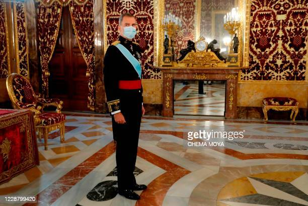 Spain's King Felipe VI wearing a face mask, attends a ceremony to present the credentials of new ambassadors in Spain at Royal Palace, in Madrid,...