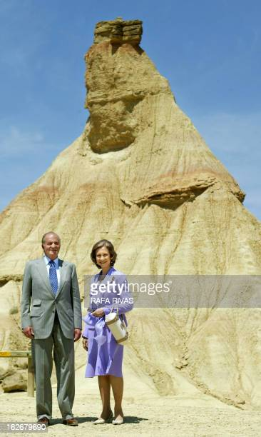 Spain's King Juan Carlos and his wife Queen Sofia pose next to 'Castilldetierra' peak during their visit in the Bardenas Reales natural park where...