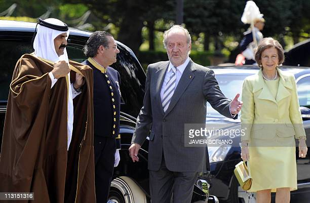 Spain's King Juan Carlos and Queen Sofia welcome the Emir of the State of Qatar Sheikh Hamad bin Khalifa AlThani at El Pardo palace in Madrid on...