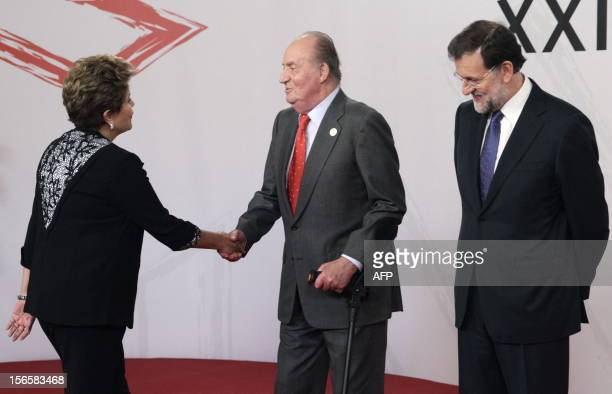 Spain's King Juan Carlos and Spain's Prime Minister Mariano Rajoy welcome Brazil's President Dilma Rousseff during the XXII IberoAmerican Summit of...