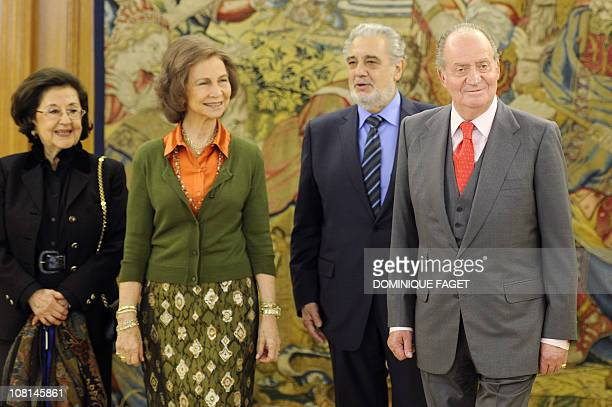 Spain's King Juan Carlos and Spain's Queen Sofia pose with Spanish tenor Placido Domingo and his wife and soprano Marta Ornelas during a lunch to...