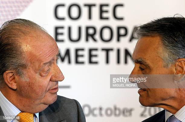 Spain's King Juan Carlos chats with Portugal's President Anibal Cavaco Silva before a meeting of the COTEC Europe Fundation at the Casa da Musica in...