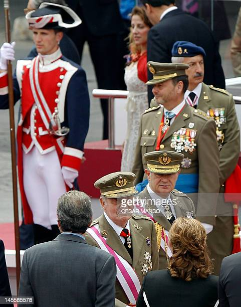 Spain's King Juan Carlos greets families of fallen soldiers during a military parade marking the Armed Forces Day on June 2, 2012 in Valladolid. AFP...