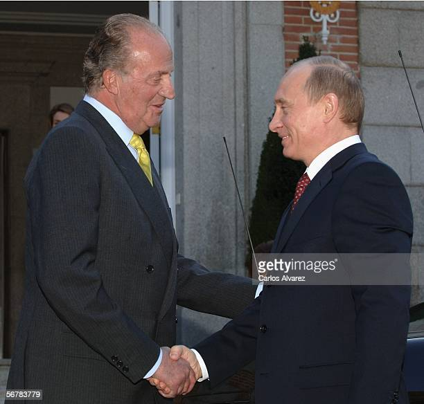 Spain's King Juan Carlos greets Russian President Vladimir Putin for a gala lunch at Zarzuela Palace on February 8 2006 in Madrid Spain