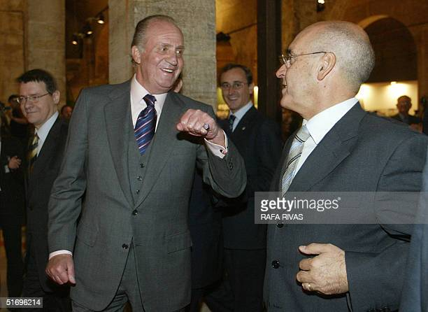 Spain's King Juan Carlos jokes with Spanish Senate's President Javier Rojo next to Vitoria's mayor Alfonso Alonso and Spanish Minister for Public...