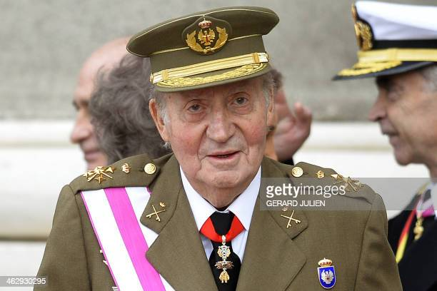 Spain's King Juan Carlos looks on during the Pascua Militar ceremony at the Royal Palace in Madrid on January 6 2014 AFP PHOTO/ POOL/ GERARD JULIEN