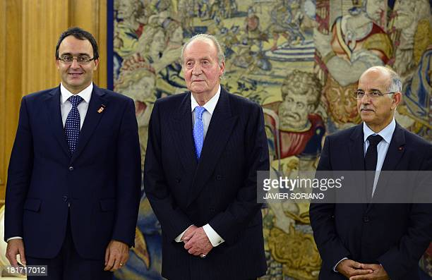 Spain's King Juan Carlos poses between Moroccan lower house president Karim Ghellab and Moroccan King's council president Mohamed Cheikh Biadillah...