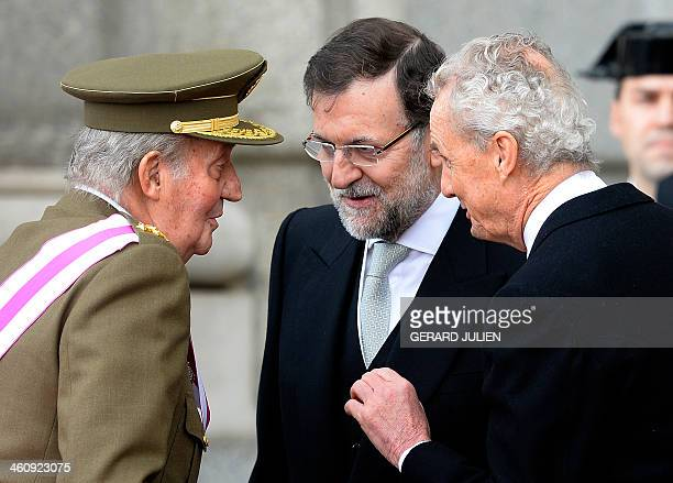 Spain's King Juan Carlos speaks with Spanish Prime Minister Mariano Rajoy and Spanish Defence Minister Pedro Morenes during the Pascua Militar...