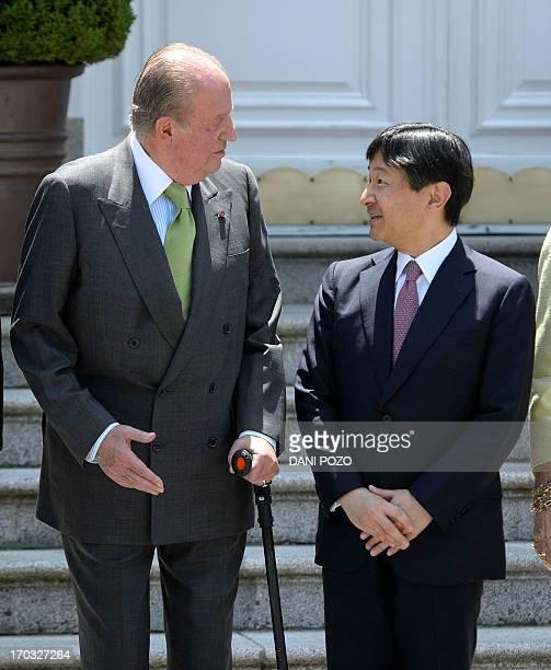 Spain's King Juan Carlos welcomes Japan's Crown Prince Naruhito at the Zarzuela Palace near Madrid on June 11 2013 Japan's Crown Prince Naruhito...
