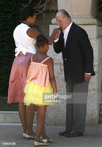 Spain's King Juan Carlos welcomes US First Lady Michelle Obama and her daughter Sasha at the Marivent Palace on August 8 2010 US First Lady Michelle...