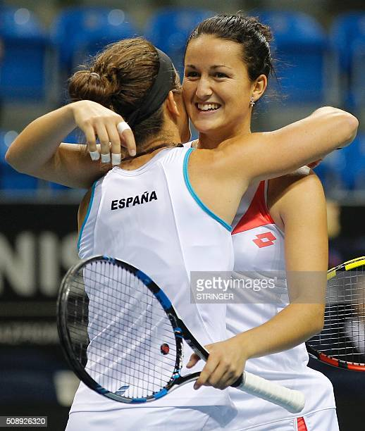 Spain's Lara Arruabarrena celebrates victory against Serbia's player Ivana Jorovic and Nina Spasojevic with her double partner Lourdes Dominguez Lino...