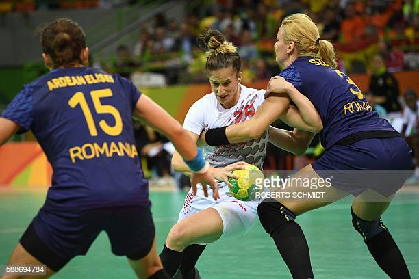 Spain's left back Nerea Pena Abaurrea vies with Romania's right back Gabriella Szucs during the women's preliminaries Group A handball match Romania...