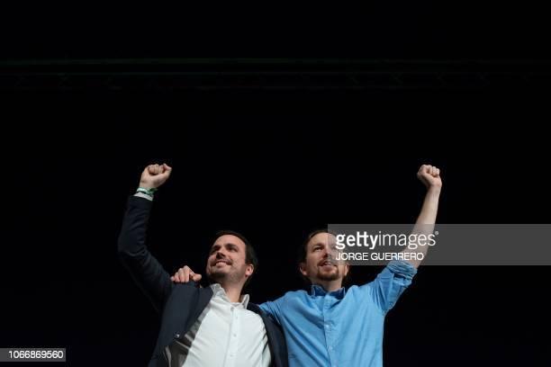 Spain's leftwing party Podemos leader Pablo Iglesias and Izquierda Unida leader Alberto Garzon attend a 'Adelante Andalucia' closing campaign rally...