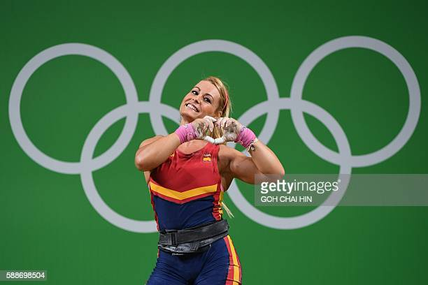 Spain's Lidia Valentin Perez gestures during the women's weightlifting 75kg event during the Rio 2016 Olympics Games in Rio de Janeiro on August 12...