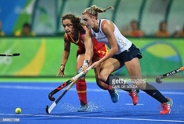 Spain's Lola Riera vies with Britain's Lily Owsley during the women's quarterfinal field hockey Britain vs Spain match of the Rio 2016 Olympics Games...
