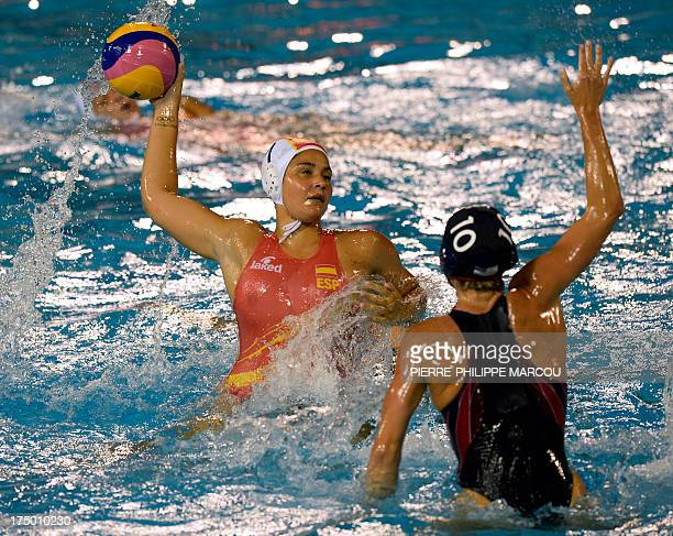 Spain's Lorena Miranda vies with US player Kelly Rulon during their women's water polo quarterfinals match at the FINA World Championships on July 29...