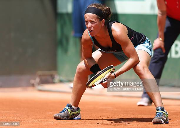 Spain's Lourdes Dominguez waits for a return of NewZealand's Marina Erakovic during their Women's Singles 1st Round tennis match of the French Open...