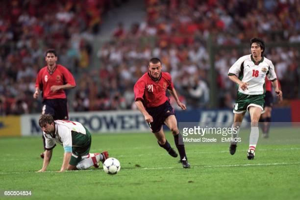 Spain's Luis Enrique bursts through the Bulgaria defence leaving Trifon Ivanov and Daniel Borimirov stranded