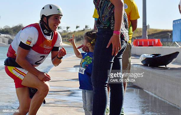 Spain's Maialen Chourraut celebrates after winning the Women's K1 final kayak slalom competition at the Whitewater stadium during the Rio 2016...