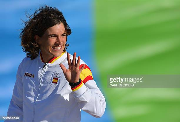 Spain's Maialen Chourraut celebrates on the podium after winning the Women's K1 final kayak slalom competition at the Whitewater stadium during the...